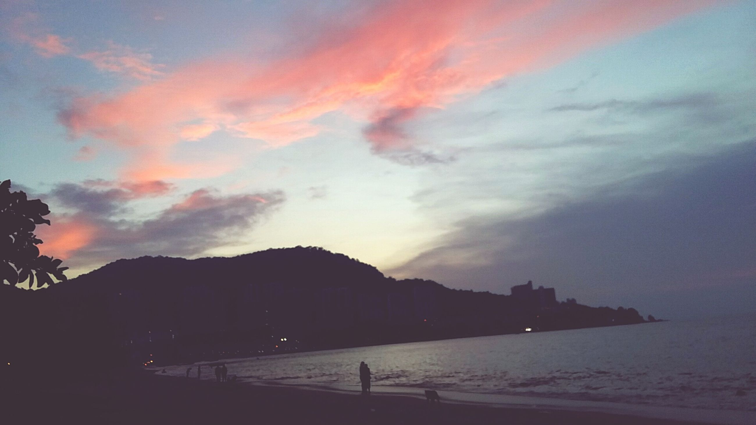 sunset, sky, scenics, silhouette, beauty in nature, tranquil scene, water, tranquility, cloud - sky, mountain, sea, nature, orange color, idyllic, beach, dusk, cloud, built structure, dramatic sky, cloudy