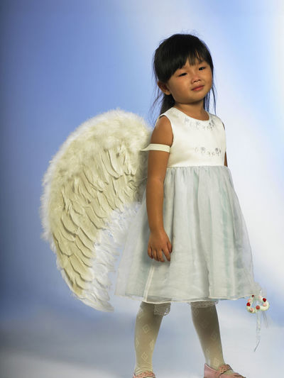 tired asian girl wearing angel wings Wreath Of Flowers Asian  Fairy Fashion Flower Girl Happiness Innocence Standing White Dress Angel Angel Wings Bangs Cheerful Child Childhood Chinese Cute Elementary Age Girls Heart Shape Portrait Sleepy Tired Wand Wing Costume