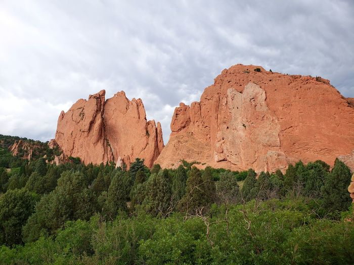 From the west side of Garden of the Gods park Monumemt Scenics Scenery Garden Of The Gods Nature Photography Nature_collection Nature Green Color Pine Tree Red Rocks  EyeEm Selects Rock - Object Sky Cloud - Sky Landscape Arid Climate Rock Formation Geology Rocky Mountains Rugged Physical Geography Sandstone