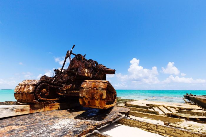 Platico Point, Turks and Caicos. Some rusty old equipment from a port project that was never completed. We were the only ones on the beach as far as we could see in either direction. Pretty surreal feeling. Sea Water Sky No People Rusty Outdoors Turks And Caicos Turksandcaicos Middle Caicos Blue Day Beach Travel Travelphotography Isolated EyeEm Selects EyeEm New Here