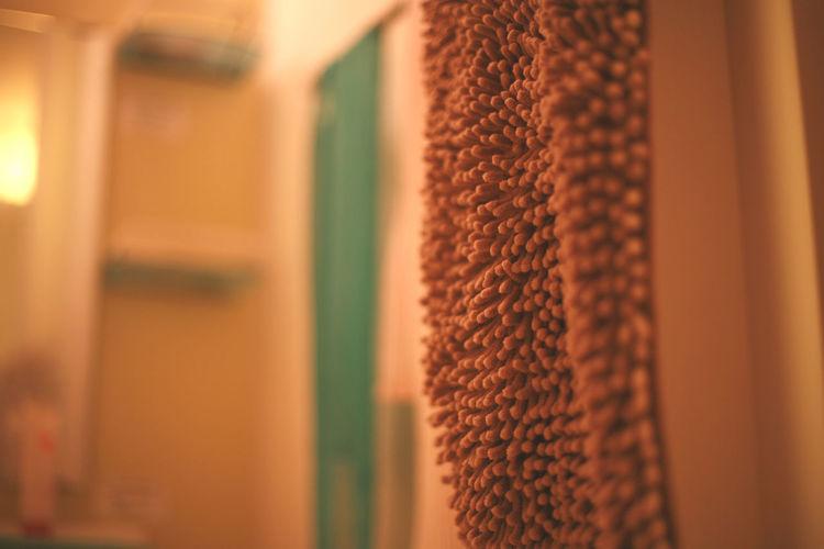 Close-up of bath mat hanging at home