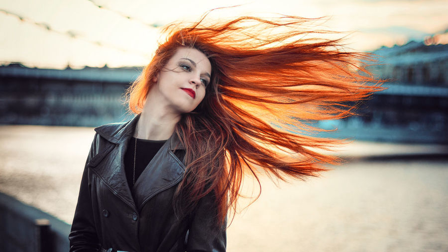 Portrait Of Young Woman With Hair Blowing In Wind