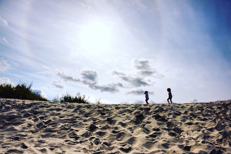 Child Relaxation Beauty In Nature Calm Sky Non-urban Scene Vacations Sand Full Length Sunlight Unrecognizable Person Child Shadows Children Beach Sand Dune Tranquility Sandy Arid Climate Tranquil Scene Sun Summer Cloud - Sky Vacations Outdoors Scenics