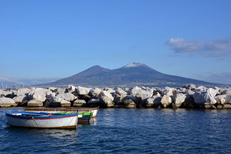Landscape of Naples Naples Napoli Napolipix Vesuvio Beauty In Nature Bestmoment Blue Boat Clear Sky Day Italy Mountain Napoliphotoproject Nature No People Outdoors Scenics Sky Stones Tranquility Vesuv Vesuvius  Water Waterfront