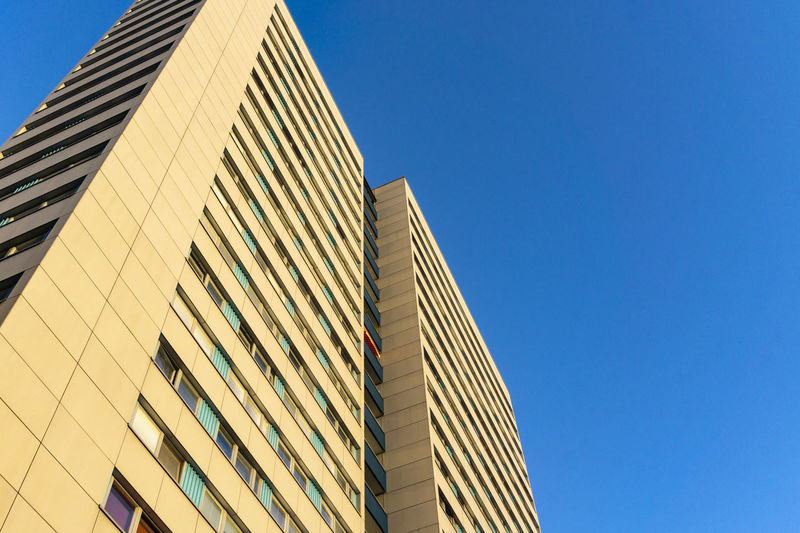Berlin, Germany, October 14, 2018: Low Angle View of Residential Building Berlin Germany 🇩🇪 Deutschland Horizontal Color Image Outdoors No People Architecture Building Exterior Built Structure Low Angle View Sky Clear Sky Building City Modern Day Skyscraper Window Glass - Material Residential Building Yellow Multi Storey Low Angle View Tall - High Sunlight