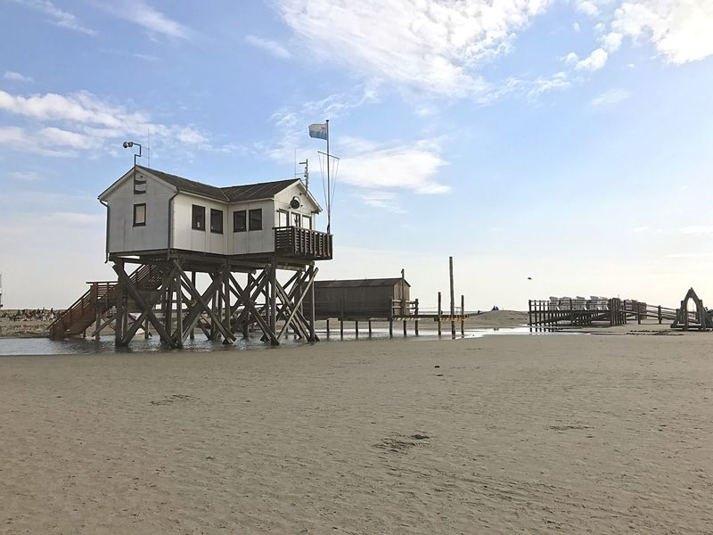 St. Peter Ording Built Structure Beach Architecture Sand Shore Building Exterior Lifeguard Hut Sea Sky Lifeguard  Water Lookout Tower Stilt House Cloud Remote Coastline Tranquil Scene Day Nature Outdoors