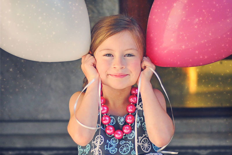 Balloons and Sparkles Balloon Casual Clothing Child Holding Balloons Child Portrait Childhood Childhood Memories Children Fun Happiness Having Fun Headshot Leisure Activity Lifestyles Little Looking At Camera Nature Party Person Pink Balloon Portrait Silly Face Smiling Smiling Little Girl Waist Up White Balloons