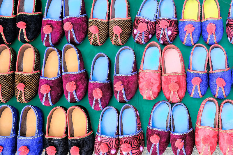Multi Colored In A Row Choice Variation Arrangement Side By Side Shoe Retail  Large Group Of Objects Market For Sale Full Frame No People Backgrounds Abundance Order Sandal Group Fashion Group Of Objects Slipper  Flat Shoe Toddler
