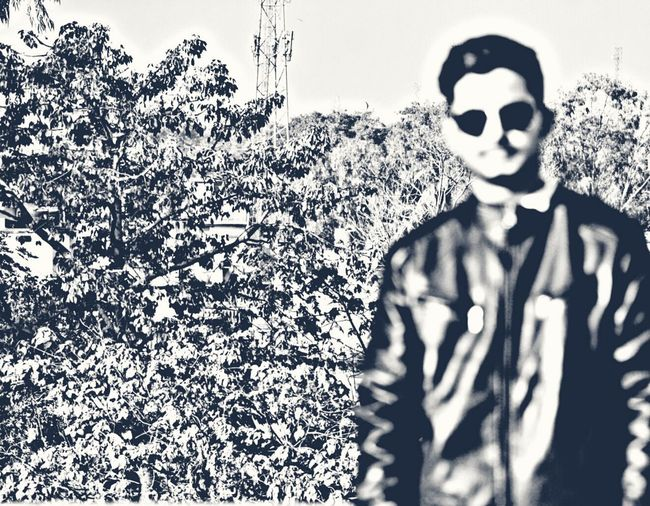 Tree One Person Front Blur Daytime Photography Naturelovers Only Men Sunglasses Leather Jacket Handsome Professionalphotography Excellent Shot Nature Spooky People Disguise One Person Evil Halloween Day Outdoors