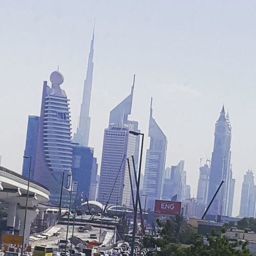Strolling at the road of Dubai while watching the iconic architectural buildings around the city of Dubai at United Arab Emirates. Skyscraper Architecture City Urban Skyline Downtown District Cityscape Modern Tower Travel Destinations Business Finance And Industry Development Business Building Exterior Office Built Structure Outdoors Sky No People Day
