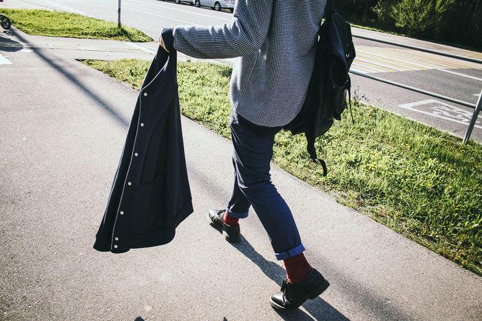 Black Jacket Casual Clothing City Life Day Grass Jacket Leisure Activity Lifestyles Outdoors Road Stylish Guy Sunlight The Way Forward Walking Around The City