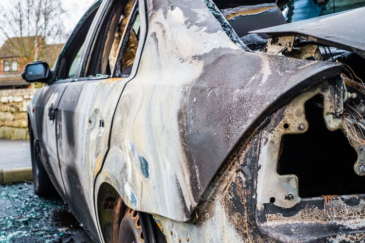 Burned Cars Crime Abandoned Burntout Car Damaged Day Deterioration Fire Land Vehicle Metal Mode Of Transportation Motor Vehicle No People Obsolete Old Run-down Rusted Transportation