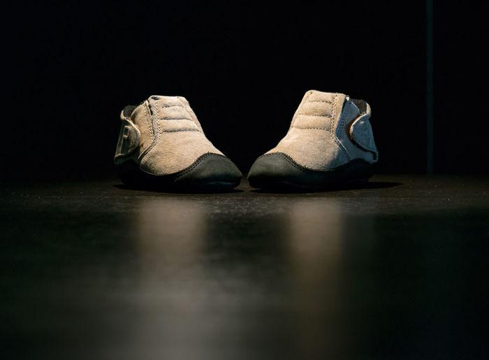 Shoes on floor in darkroom
