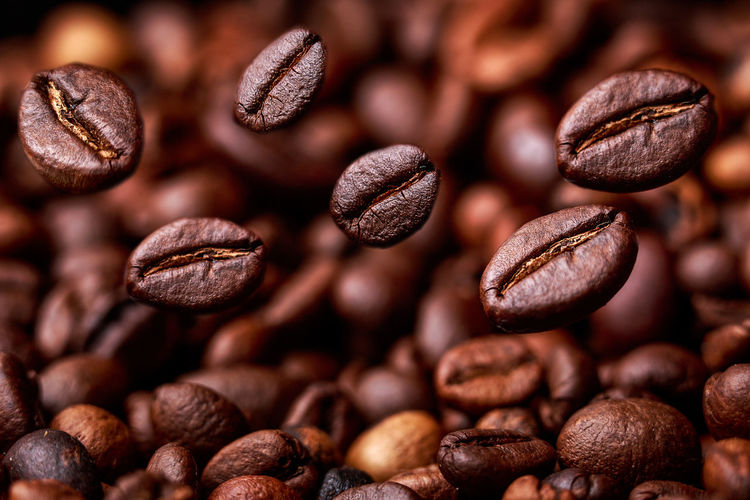 Flying coffee beans Beans Caffeine Coffee Coffee Time Fly Morning Raw Seed Arabica Aroma Aromatic Background Black Brown Close-up Coffe Beans Coffee Break Detail Fall Flying Focus On Foreground Full Frame Grain No People Studio Shot