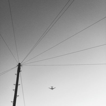 Low Angle View Connection Electricity  No People Outdoors Power Line  Sky Scenics Street Photography Streetphoto_bw Black And White Eye4black&white  Eye4photography  Blancetnoir Low Angle View Connection Electricity  Cable Power Line  Electricity Pylon Flying Day Power Supply Outdoors Sky