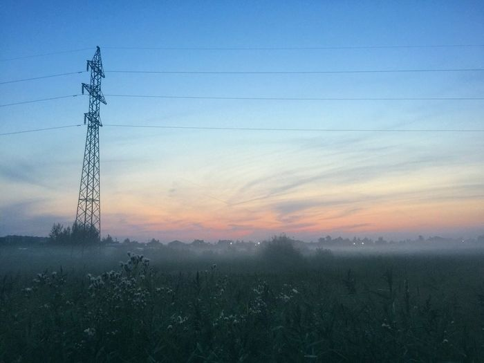 Cable Electricity Pylon Electricity  Power Supply Power Line  No People Field Connection Fuel And Power Generation Nature Landscape Tranquility Day Sky Outdoors Sunset Technology Tree Beauty In Nature Grass