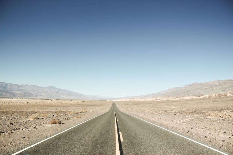 Road The Way Forward Clear Sky Copy Space Landscape Transportation Empty Road Day Scenics Asphalt Outdoors Mountain Desert Non-urban Scene Mountain Range Arid Climate Tranquility Miles Away Nature Sky Death Valley National Park Landscapes Tourism Travel Travel Destinations