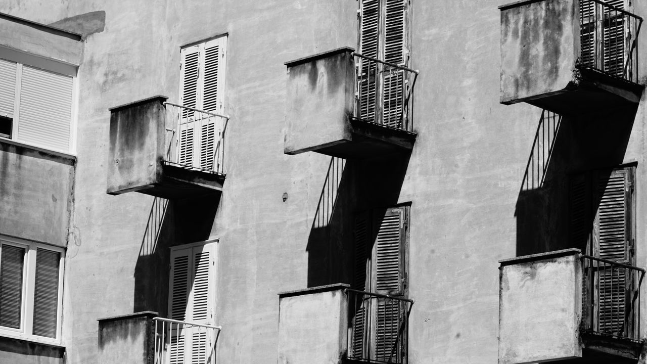 architecture, built structure, building exterior, building, low angle view, window, no people, day, city, residential district, outdoors, nature, full frame, in a row, backgrounds, shadow, modern, sunlight, wall - building feature