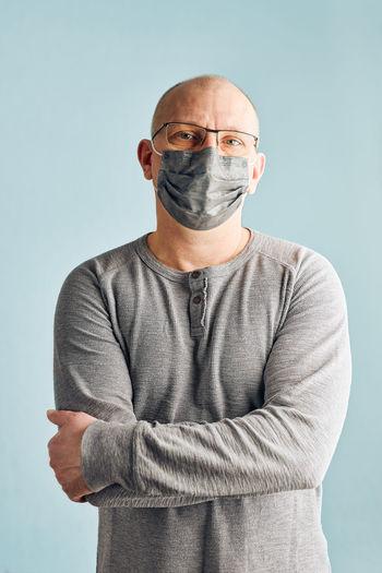 Portrait of a man against blue background