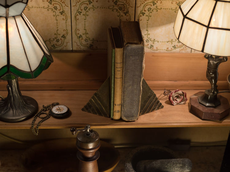 Object Photography Training: Nostalgia Tranquility Fob Watch Lamps Lampshades Mortar And Pestle Night No People Nostalgia Object Photography Old Books Pepper Mill Studio Shot Tiffany Lamp Tiles Tranquil Scene Wood - Material