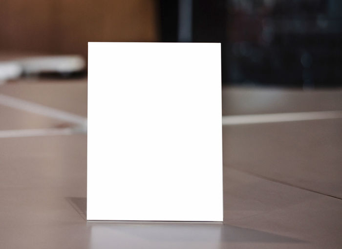 Close-up of paper on table