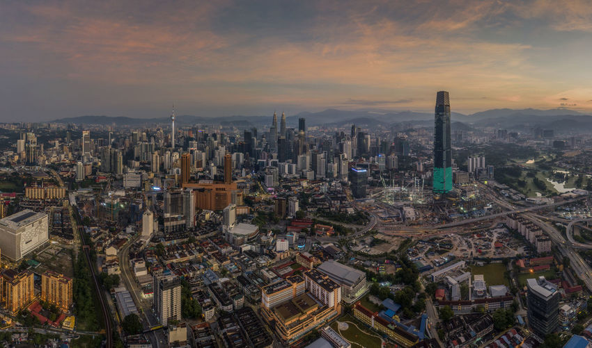 Aerial view of kuala lumpur city during sunrise City Cityscape Architecture Built Structure Building Exterior Sky Cloud - Sky Building Office Building Exterior Crowd High Angle View Aerial View Travel Destinations Skyscraper Sunset Crowded Tower Tall - High Nature Modern Outdoors Sunrise Panorama Panorama View