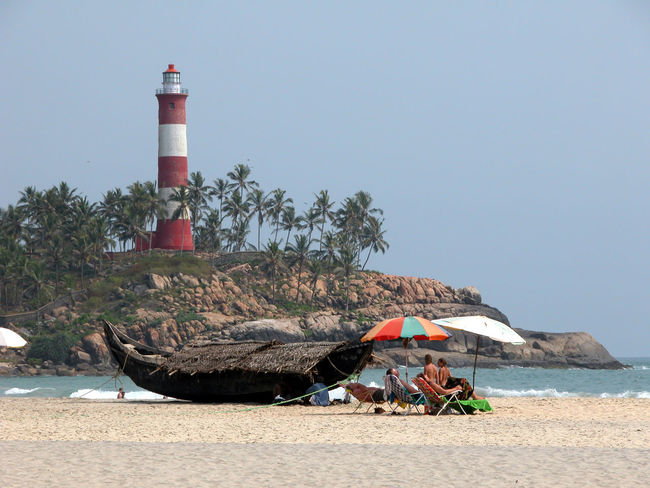 Lighthouse and beach in Kovalam. Beach Boat India Kovalam Lighthouse Sea Summer Vacation