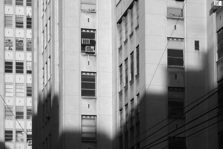 buildings A/c Air Conditioner Black & White EyeEm Selects Lines Low Angle View Sunlight Abstract Apartment Architecture Black And White Blackandwhite Building Building Exterior Built Structure City Corner Day Design From Below Full Frame Glass - Material Looking Up Modern No People Office Outdoors Parallel Pattern Reflection Repetition Residential District Shadow Skew Sunlight Wall Window The Architect - 2018 EyeEm Awards