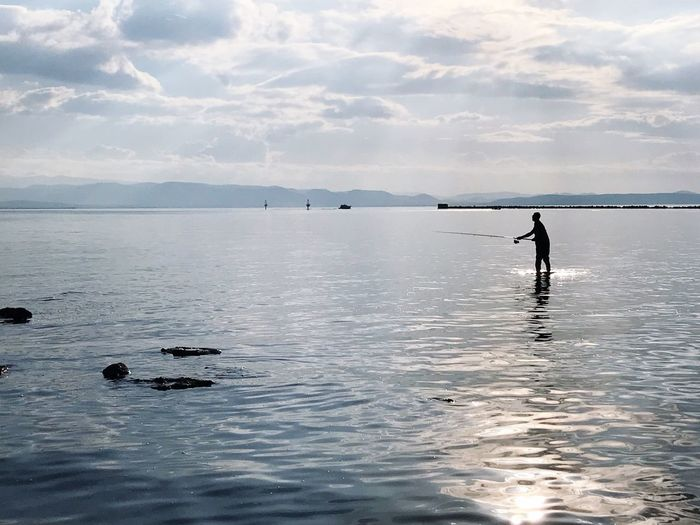 Fishing Water Sky Sea Beauty In Nature Scenics - Nature Waterfront Cloud - Sky Tranquility Reflection Nature Real People Non-urban Scene Horizon Over Water Tranquil Scene Men Outdoors