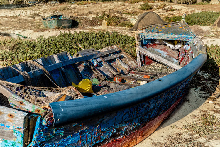 Old boat moored on beach