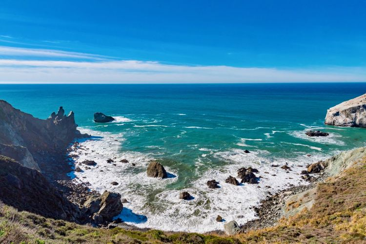 Sea Water Sky Scenics - Nature Rock Horizon Beauty In Nature Horizon Over Water Rock - Object Solid Blue Land Tranquil Scene Nature Tranquility Beach Day Rock Formation No People Outdoors Rocky Coastline Turquoise Colored Stack Rock