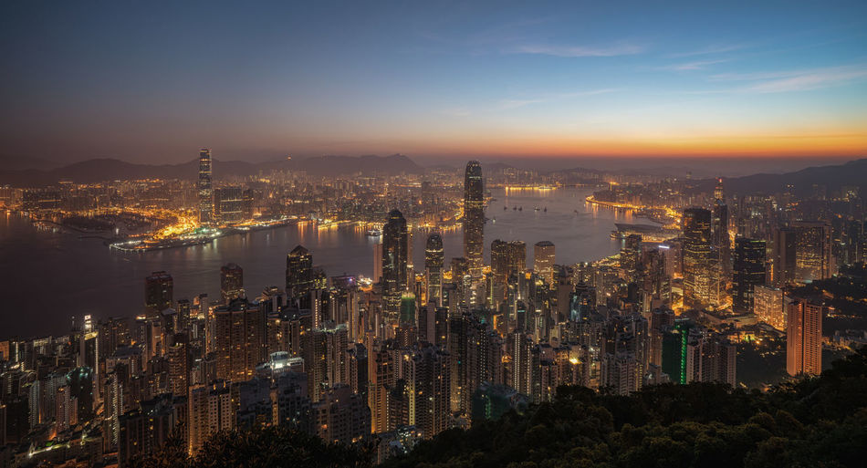 Hong Kong skyline, just before sunrise seen from The Peak Hong Kong Hong Kong City Aerial View Architecture Building Exterior Built Structure China City Cityscape Downtown District Full Frame Illuminated Modern Outdoors Skyline Skyscraper Success Sunrise Travel Destinations Urban Landscape Urban Skyline