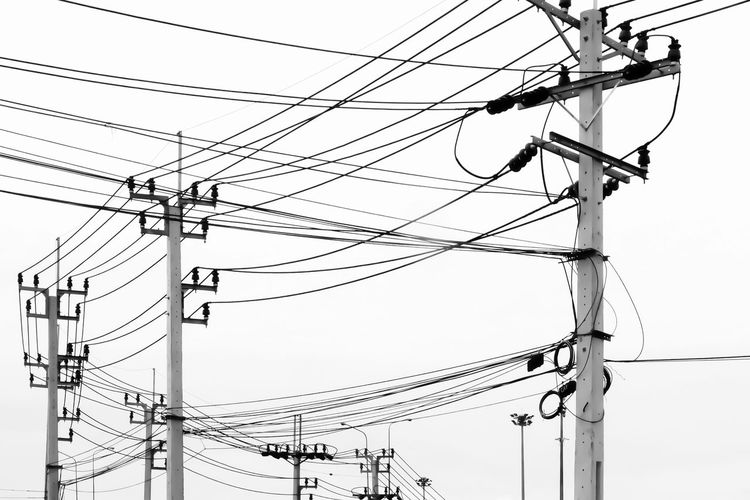 Cable Clear Sky Complexity Connection Day Electrical Component Electrical Equipment Electricity  Electricity Pylon Fuel And Power Generation Lighting Equipment Low Angle View Metal Nature No People Outdoors Pole Power Line  Power Supply Sky Tangled Technology Telephone Line