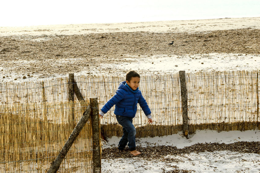 Beach Boys Child Childhood Day Full Length One Boy Only One Person Outdoors Sand Warm Clothing