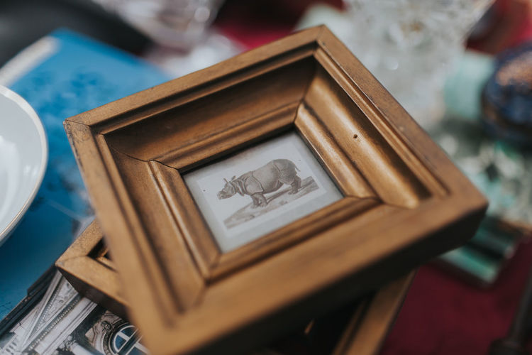 Close-up of picture frame at market stall