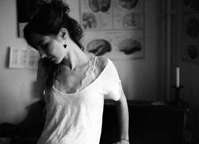Analog Beautiful Woman Blackandwhite Casual Clothing Contemplation Domestic Room Focus On Foreground Front View Hairstyle Home Interior Indoors  Leisure Activity Lifestyles Looking Looking Away Mediumformat One Person Real People Standing Teenager Waist Up Women Young Adult Young Women