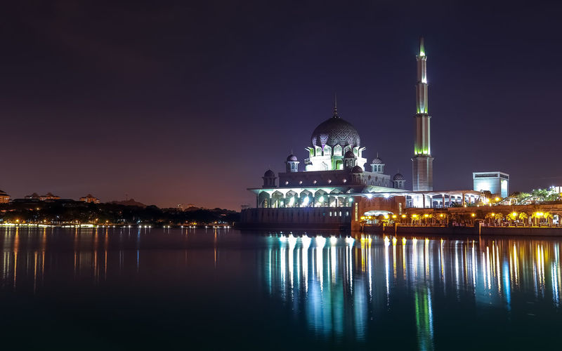 Beautiful night scenery before dawn at beautiful Putra Mosque with a reflection of the light at the lake surface. Showing a beauty in islamic architecture. Building Exterior Architecture Illuminated Built Structure Religion Water Belief Sky Night Place Of Worship Reflection Spirituality Dome Building No People Waterfront City Outdoors Spire  Mosque Islamic Architecture Malaysia Putrajaya Putra Mosque This Is Natural Beauty