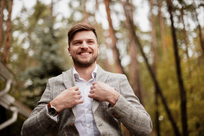 young man in suit Adult Beard Cheerful Emotion Facial Hair Forest Front View Hand Happiness Land Males  Men Nature One Person Outdoors Plant Portrait Smiling Tree Waist Up Young Adult
