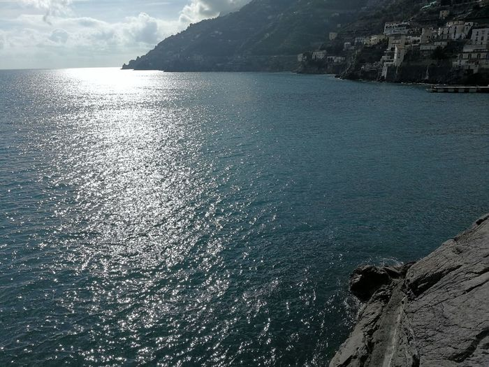 Water Sea Beauty In Nature Scenics - Nature Tranquility Tranquil Scene Sky Day Nature Rock Sunlight No People Mountain Solid Rock - Object Outdoors Reflection Idyllic Rippled Rocky Coastline Amalfi Coast