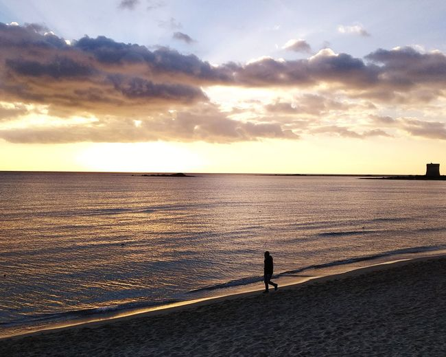 Mare Tramonto Sunset Tower Torre Cielo Spiaggia Solitude Solitudine Man Only Men Water Sea Full Length Sunset Beach Standing Silhouette Sand Sky Horizon Over Water Romantic Sky Calm Sandy Beach Outline My Best Photo
