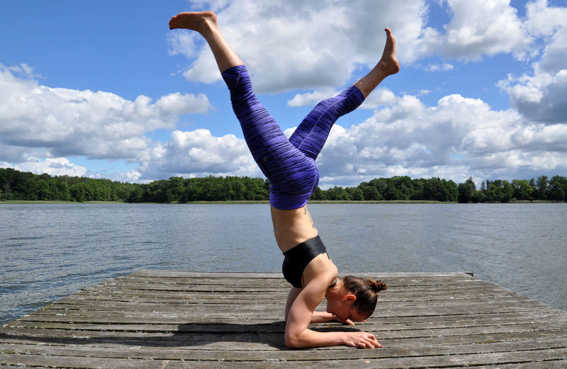 yoga poses at the lakeside Active Active Lifestyle  Body & Fitness Bright Bright Colors Cloud Color Of Sport Colorful Colors Fitness Lake Lifestyles Pier Sky Sky And Clouds Sport Tranquility Yoga Yoga Pose Women Around The World