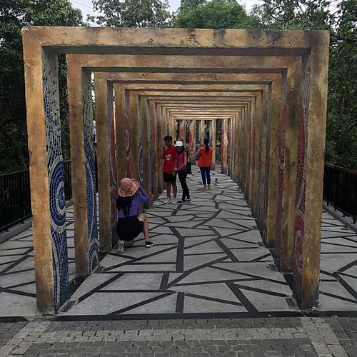 Follow the path Full Length Architecture Built Structure Walking Real People Day Men Outdoors Architectural Column Togetherness People