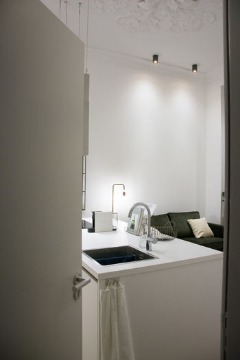 Sink Home Indoors  Domestic Room Household Equipment Absence No People Mirror Modern Hygiene Illuminated Home Interior Lighting Equipment Home Showcase Interior Reflection Bathroom Sink White Color Clean Luxury Open Door