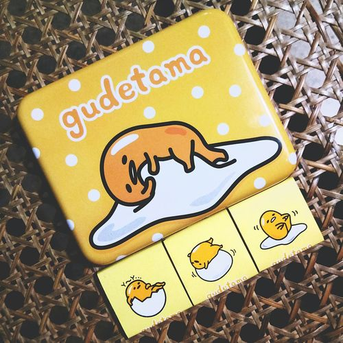 Gudetama - an egg with crippling anxiety. These are chocolates from Sanrio. High Angle View Gudetama Egg Yolk Anxiety  Taiwan Sanrio Japan Chocolate Dark Chocolate