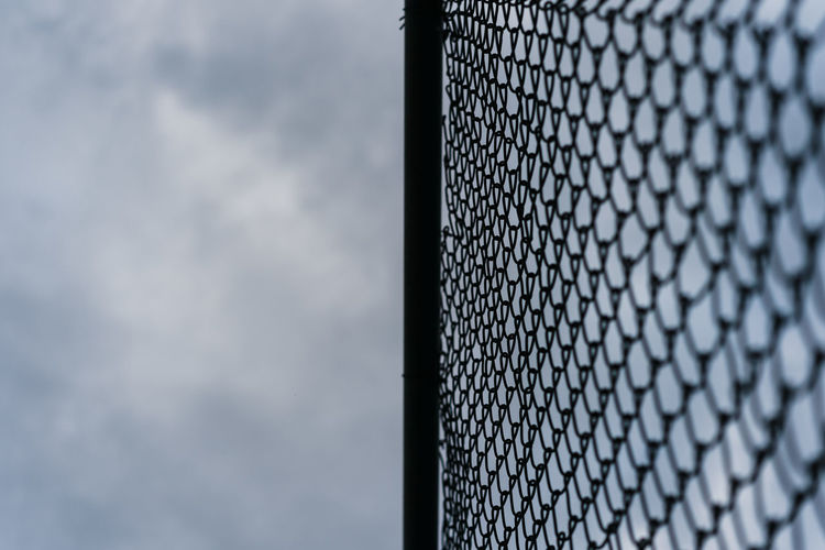 texture Sky Cloud - Sky No People Pattern Building Exterior Low Angle View Architecture Day Nature Built Structure Close-up Modern Protection Outdoors Security Metal Fence Sport Selective Focus Chainlink Fence