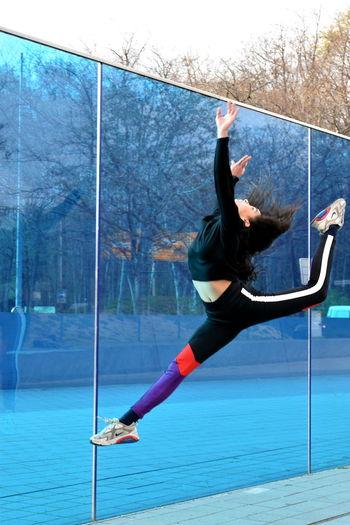 Woman standing on glass window