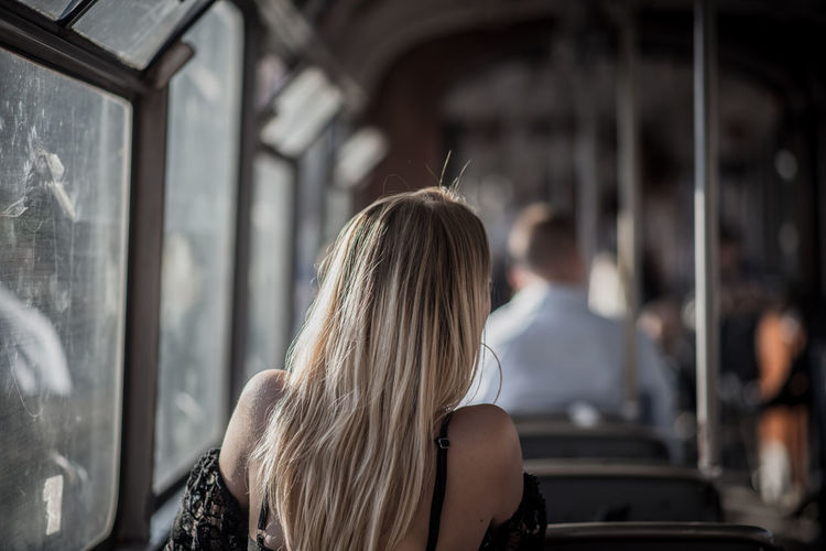 Rear view of woman traveling in bus