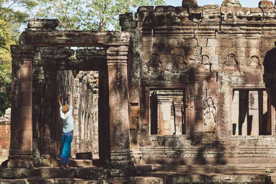 Siem Reap Cambodia Angkor Curly Hair Girl Architecture Built Structure History The Past Ancient Building Exterior One Person Building Old Ruin Travel Destinations Religion Day Standing Old Real People Tourism Travel Belief Architectural Column Spirituality Ancient Civilization Ruined Outdoors Archaeology