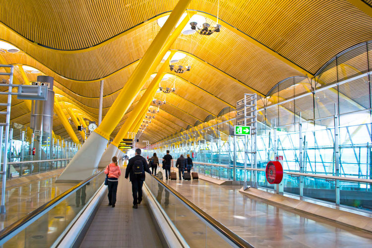 Terminal 4 departures area in the Adolfo Suárez Madrid–Barajas Airport. It is the main international airport serving Madrid in Spain. Terminals T4 and its satellite, T4S, designed by architects Antonio Lamela and Richard Rogers, and directed by architect Luis Vidal. Airport Arhitecture Barajas Built Structure City Life Design Illuminated Lifestyles Madrid Madrid Spain Modern Modern Architecture SPAIN Terminal Terminal4 The Architect - 2016 EyeEm Awards The Great Outdoors - 2016 EyeEm Awards Tourism Tourist Tourist Attraction  Travel Photography Traveling Trip Your Design Story