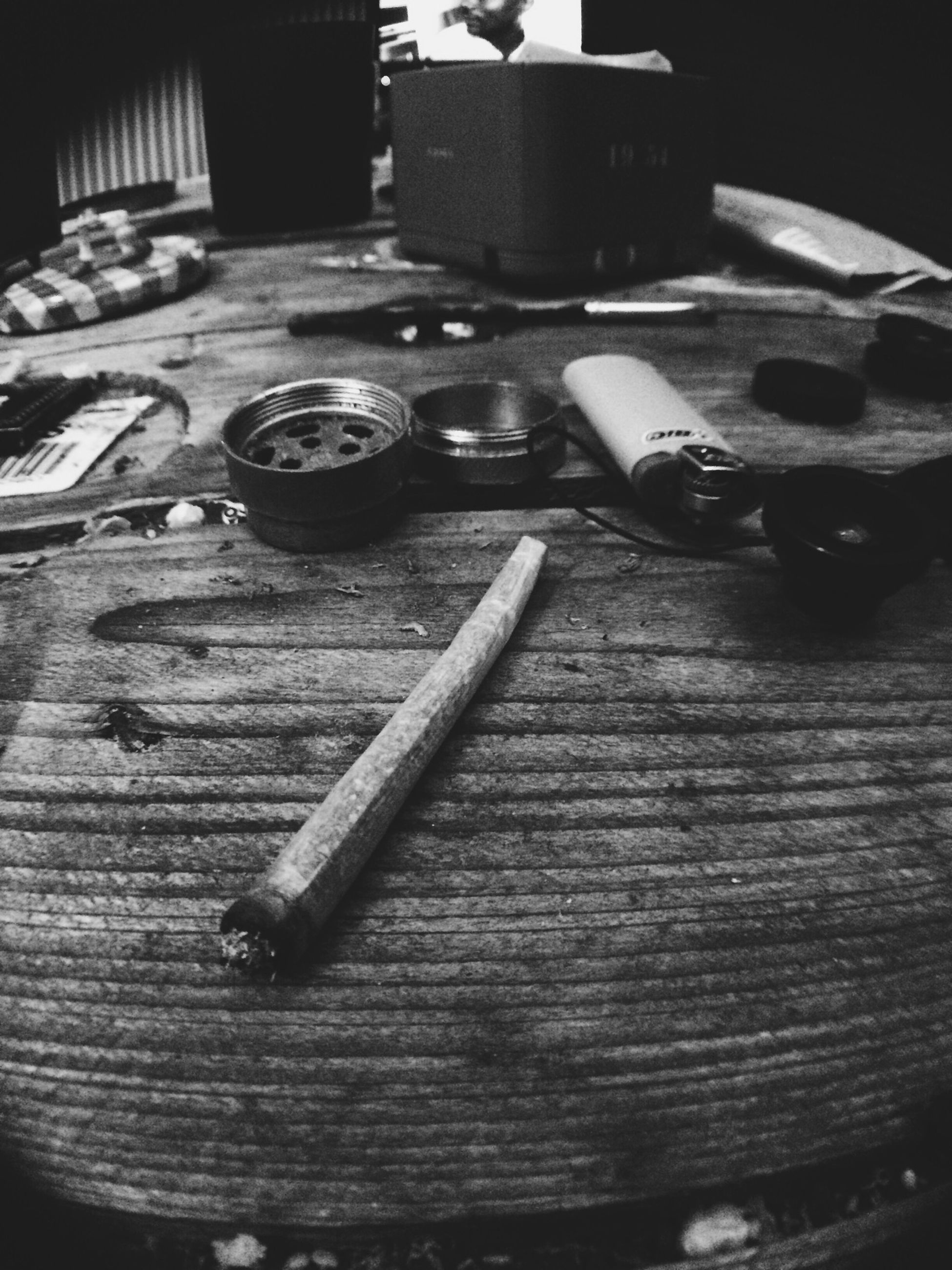 indoors, wood - material, table, high angle view, still life, wooden, old-fashioned, close-up, old, wood, no people, retro styled, equipment, metal, selective focus, home interior, absence, hardwood floor, technology, machinery
